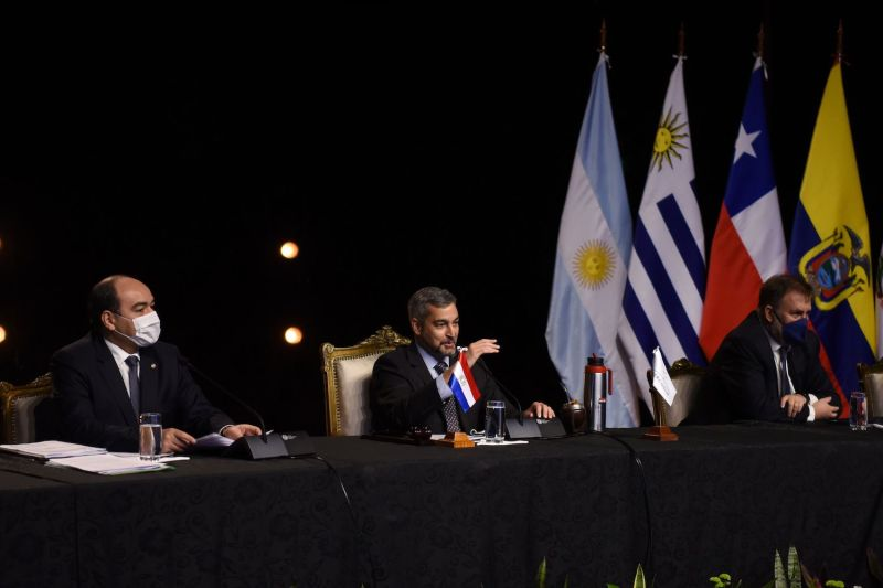 Paraguayan President Mario Abdo Benitez (C), flanked by his Foreign Minister Antonio Rivas (L), and Finance Minister Benigno Lopez, delivers a speech during the first Mercosur Summit held via video conference due to the COVID-19 at the Central Bank headquarters in Asuncion, on July 2, 2020.