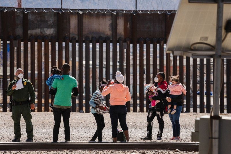 U.S. Border Patrol agents apprehend a group of migrants near downtown El Paso, Texas, on March 15.