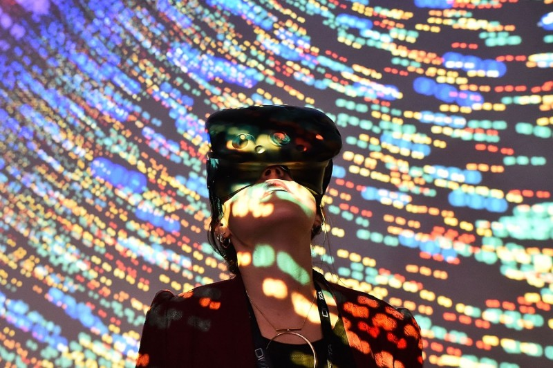 "A visitor uses a virtual reality headset during the ""Laval Virtual"" virtual reality, augmented reality, and 3D technology show in Laval, France, on April 6, 2018."