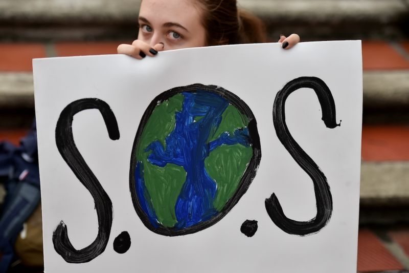 A woman holds a sign during a climate protest in Cali, Colombia, on Sept. 20, 2019.