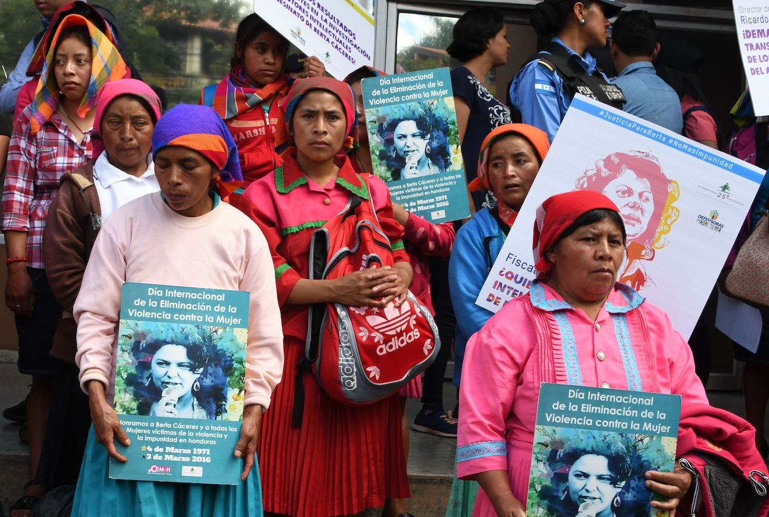 Women take part in a protest to demand justice in the murder of Honduran activist Berta Caceres at the Public Ministry headquarters in Tegucigalpa on March 2, 2018.