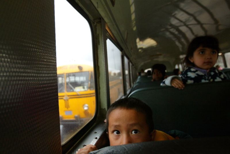 Pao Ge Vang, 5, waits for the school bus to take him home after his second day in kindergarten at Herndon-Barstow Elementary School in Fresno, California, on Dec. 10, 2004. The Vangs are among thousands of Hmong refugees who fled Laos for Thailand 30 years ago and were part of the current U.S government resettlement program for up to 15,000 Hmong.