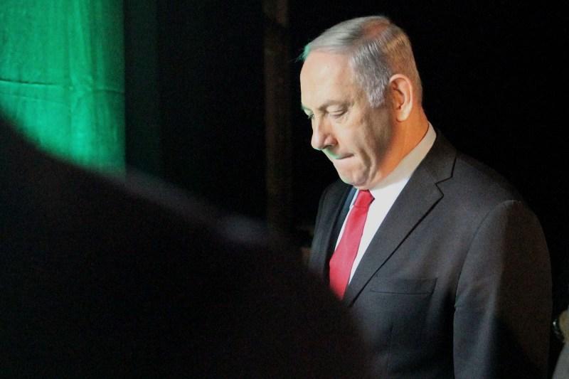 Israeli Prime Minister Benjamin Netanyahu leaves the Muni World conference in Tel Aviv, Israel, on Feb. 14, 2018.