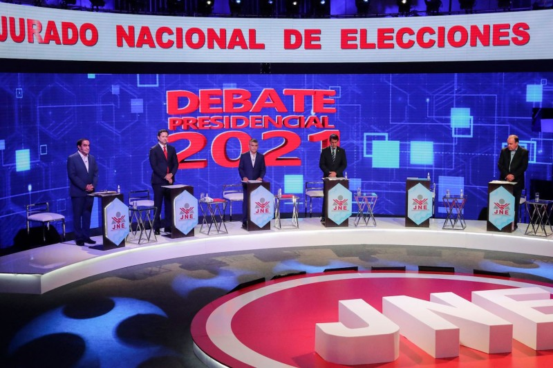 General view of Peruvian presidential candidates during the third and final televised debate organized by the National Electoral Jury in Lima on March 31.