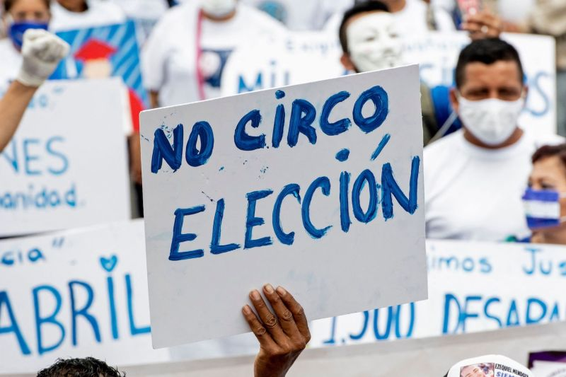 "A Nicaraguan living in Costa Rica displays a placard reading ""No Circus. Election"" during a demonstration in San Jose to commemorate the third anniversary of the protests against Nicaraguan President Daniel Ortega, on April 18."
