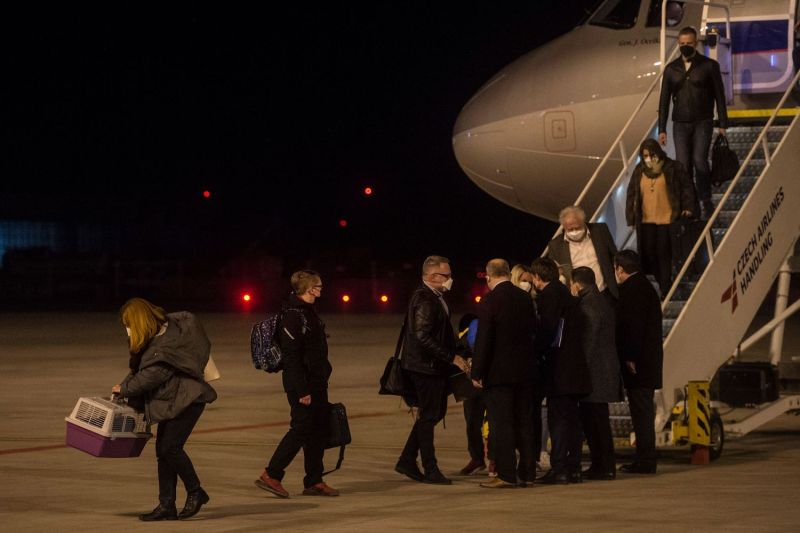 Members of the Czech Embassy in Russia arrive at the airport.
