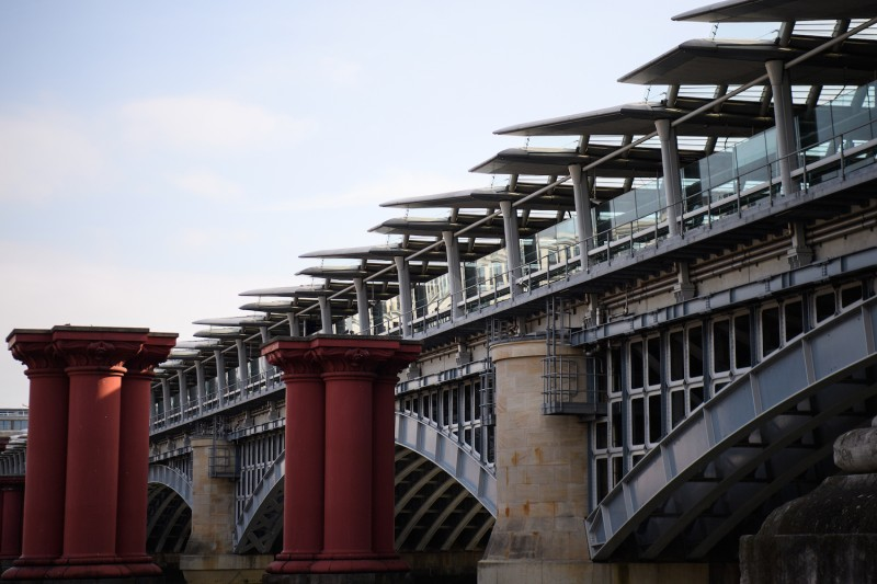The paneled roof of Blackfriars Bridge, currently the world's largest solar-powered bridge, is seen from the south bank of the River Thames in London on July 4, 2017.