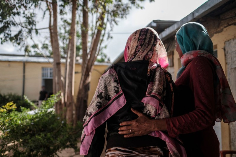 A woman is held by an assistant at a safe house for survivors of sexual assault in Mekele, the capital of Ethiopia's Tigray region, on Feb. 27.