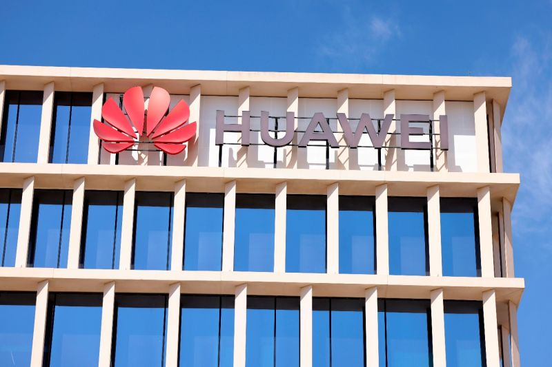 The Huawei logo is shown on a building