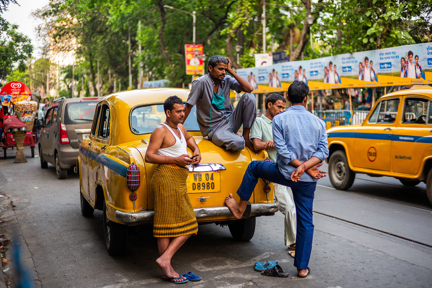 A taxi driver chats with friends along a street in Kolkata, India, on April 5. JEWEL SAMAD/AFP via Getty Images