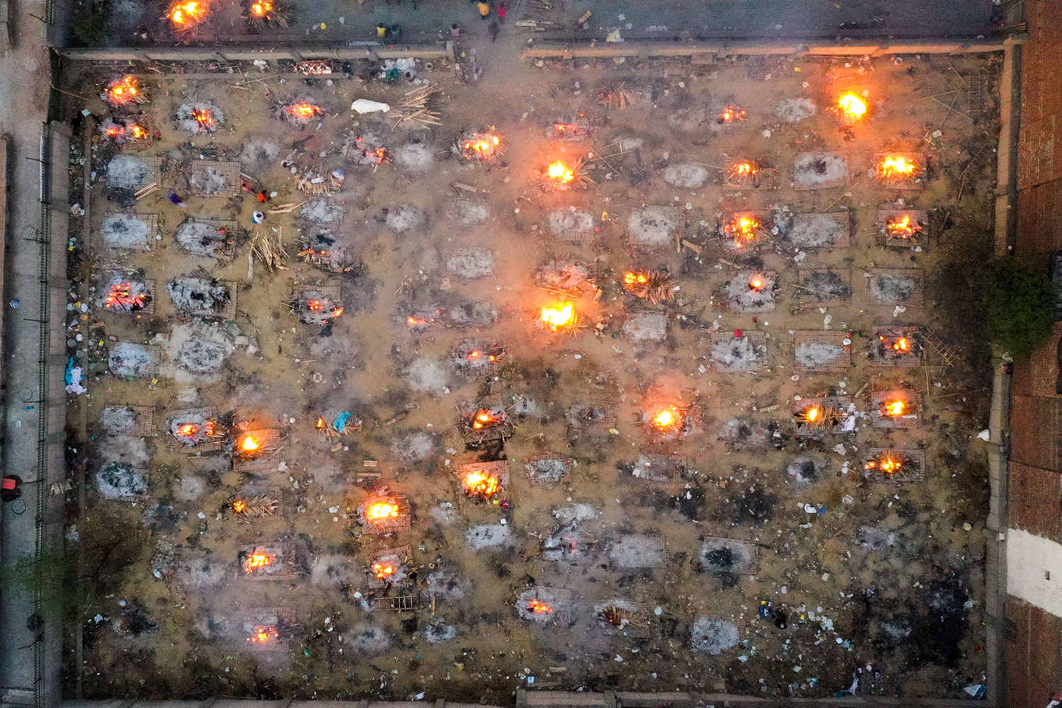 Burning pyres of victims who lost their lives from COVID-19 are seen at a cremation ground in New Delhi on April 26. JEWEL SAMAD/AFP via Getty Images