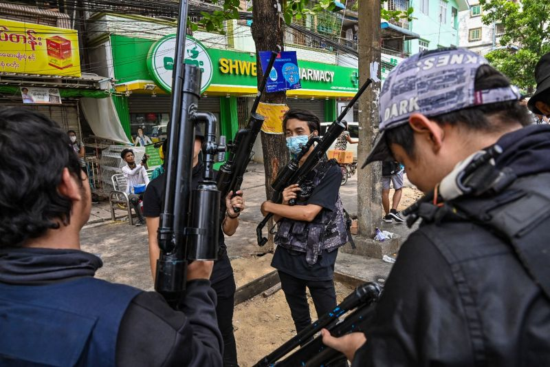 Protesters hold homemade weapons during a demonstration against the military coup in Yangon's Tamwe township in Myanmar on April 3.