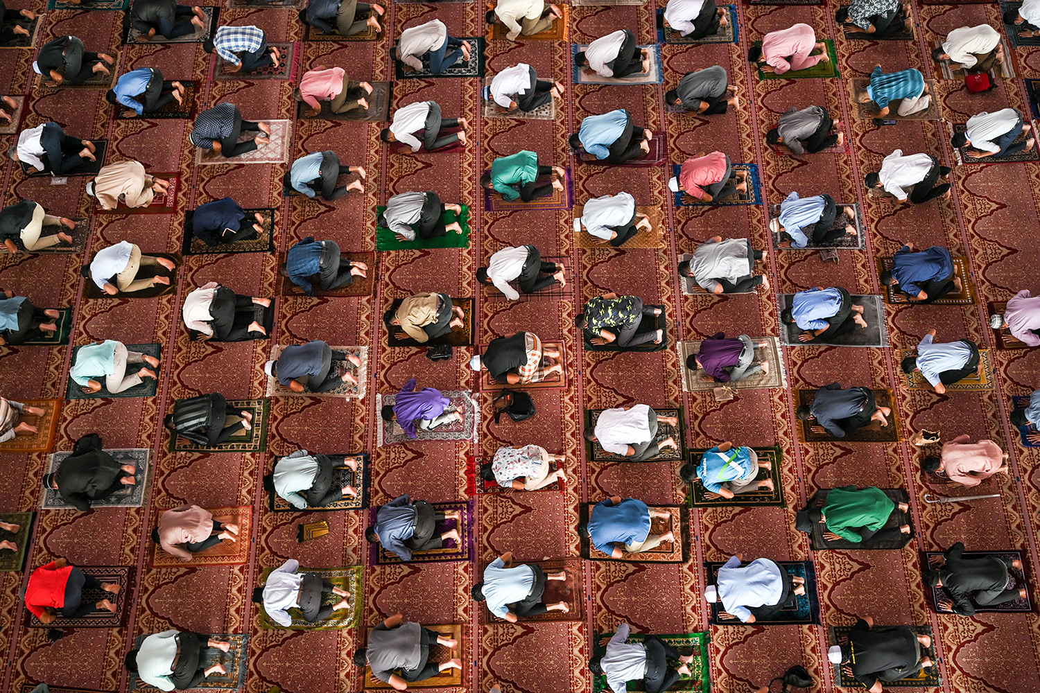 Muslims devotees practice social distancing during prayers on the first Friday of the holy month of Ramadan at the Putra Mosque in Putrajaya, Malaysia, on April 16. MOHD RASFAN/AFP via Getty Images