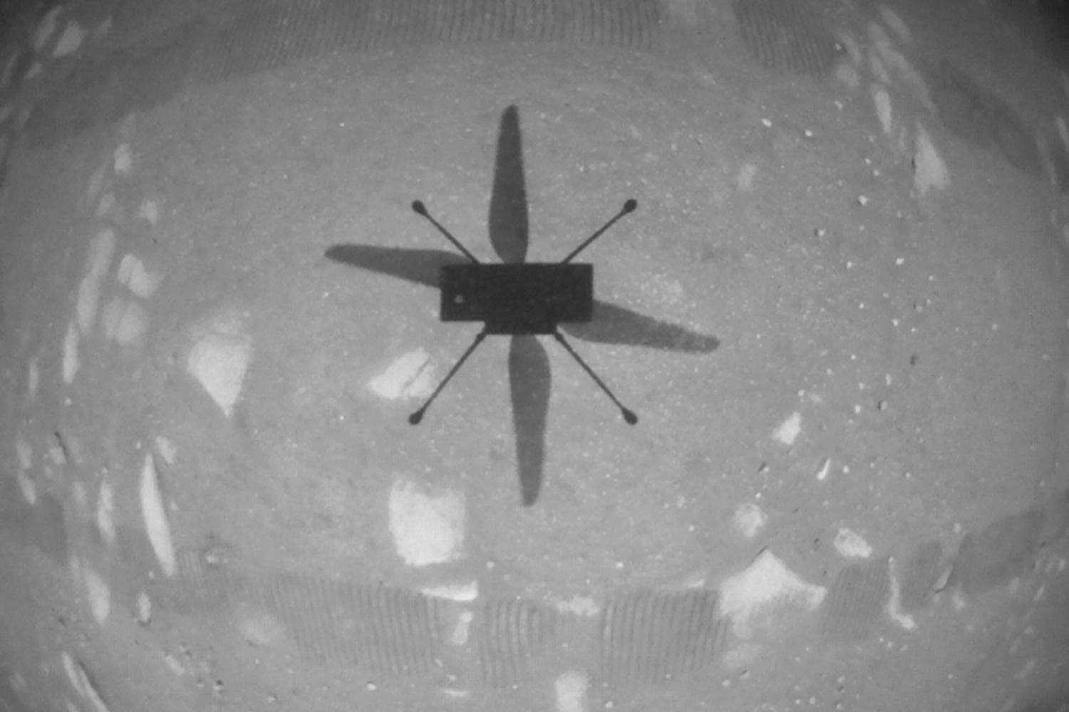 NASA's Ingenuity Mars helicopter took this shot while hovering over the Martian surface on April 19—the first instance of powered, controlled flight on another planet. NASA/JPL-Caltech via Getty Images