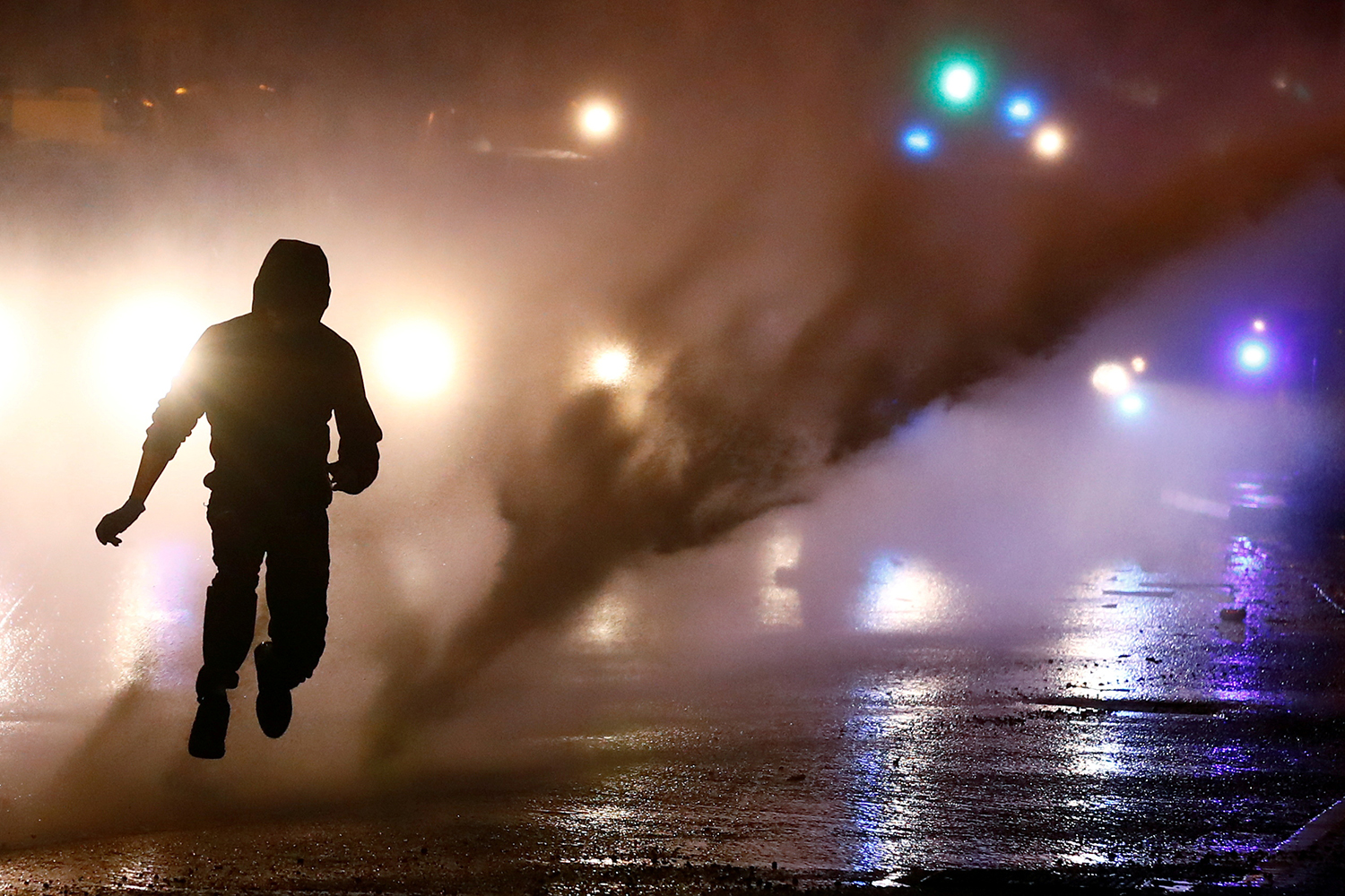 A rioter leaps as police use a water cannon during protests in Belfast, Northern Ireland, on April 8. Jason Cairnduff/Reuters