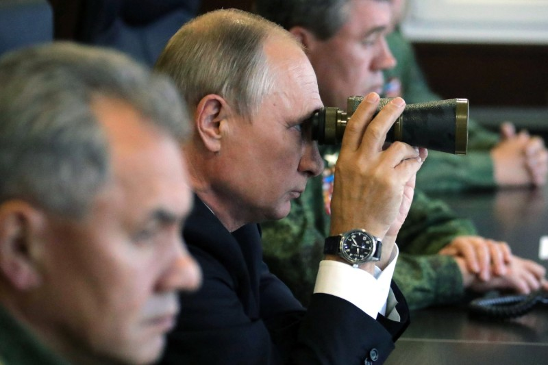 Russian President Vladimir Putin inspects military exercises.