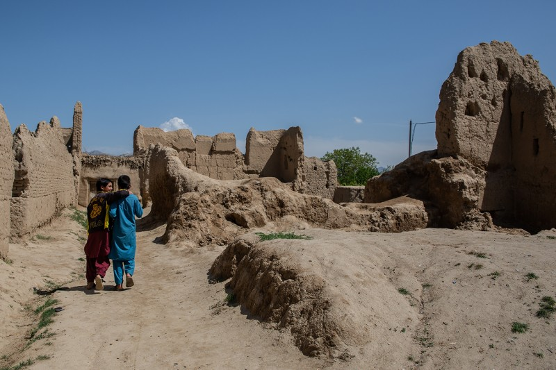 Children walk through ruins in the Qarabagh district of Afghanistan.