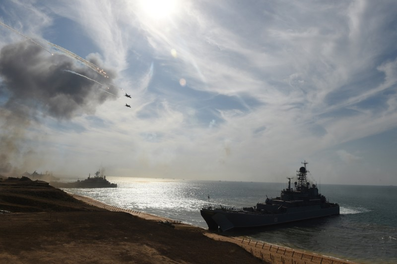 Russian warships and military jets take part in a military exercise.
