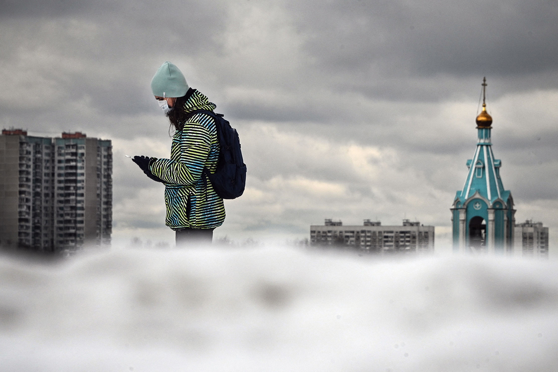 A pedestrian walks in western Moscow on April 3. ALEXANDER NEMENOV/AFP via Getty Images