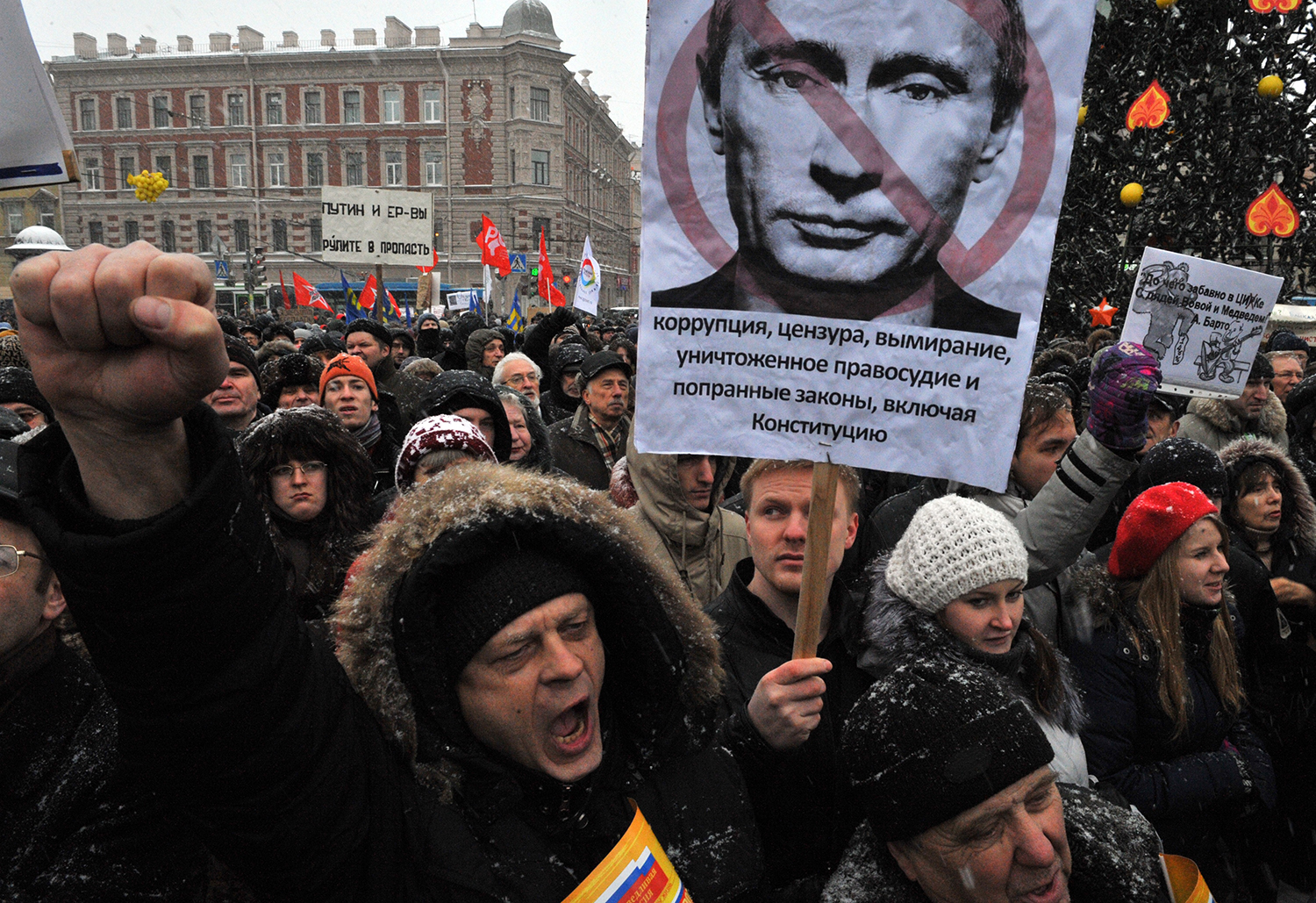 A protester holds a poster of Russian Prime Minister Vladimir Putin during a rally in St. Petersburg in 2011.