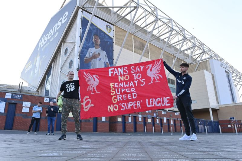 Leeds United fans hold a banner against plans for a European Super League and the involvement of the Liverpool football club outside Elland Road stadium in Leeds, northern England, on April 19.