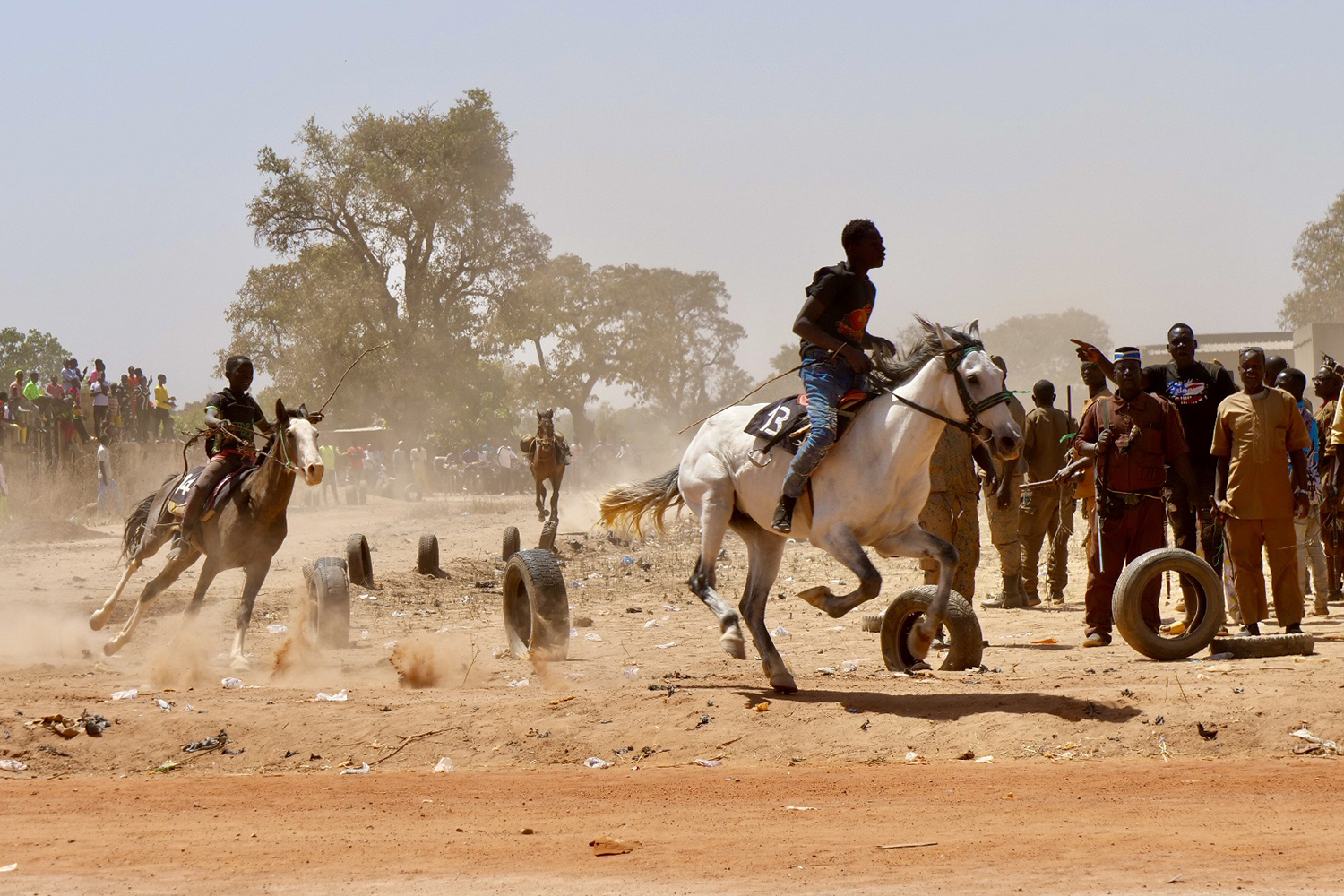 Young boys race horses at the start of the Koglweogo's gathering in Siguinvousé on Feb 14.