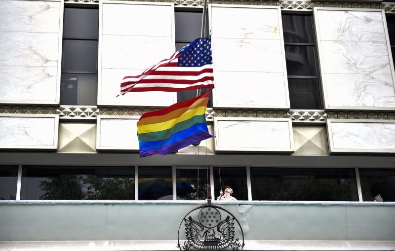 A U.S. flag and pride flag are raised at the U.S. embassy in Mexico.