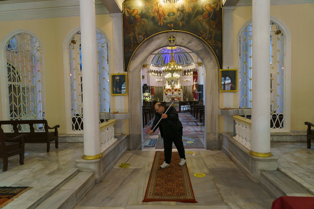 Sahak Tavukcu mops the floor of the Surp Hresdagabet Church in Istanbul.
