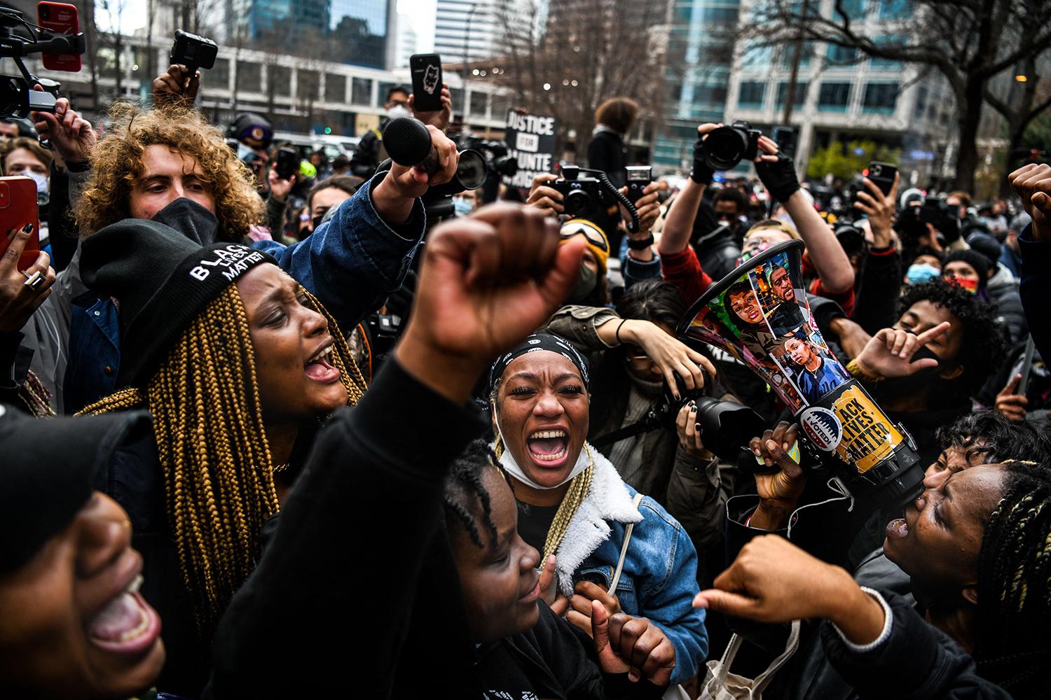 People celebrate as the verdict is announced in the trial of former police officer Derek Chauvin outside the Hennepin County Government Center in Minneapolis, Minnesota, on April 20. Chauvin was convicted of murder and manslaughter in the death of George Floyd. CHANDAN KHANNA/AFP via Getty Images