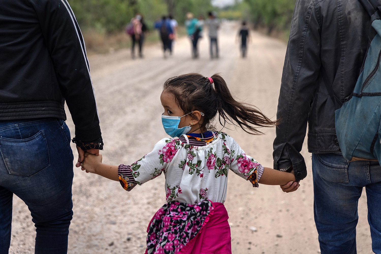 A child glances back toward the Mexican border after crossing into the United States in La Joya, Texas, on April 14. John Moore/Getty Images