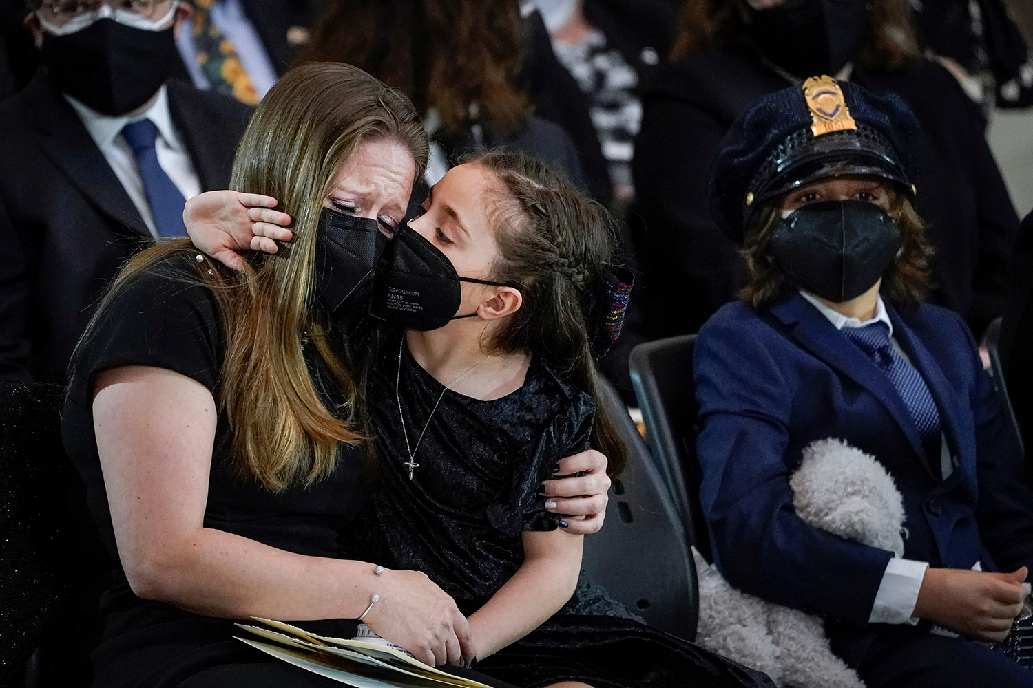 The children of slain U.S. Capitol Police Officer William Evans sit with their mother during his memorial service at the Rotunda of the U.S. Capitol in Washington on April 13. Drew Angerer/Reuters