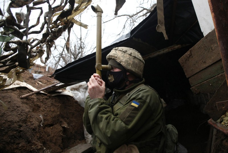 A Ukrainian serviceman stands guard at a position on the front line with Russia-backed separatists near the small city of Marinka, Donetsk, on April 12.