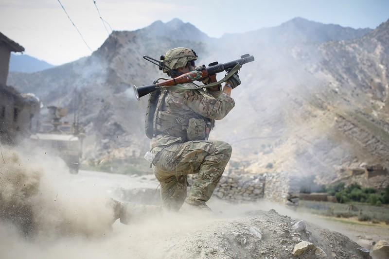 A U.S. soldier fires a rocket-propelled grenade during a firefight with insurgents in the Pech Valley, Afghanistan, on June 22, 2012.