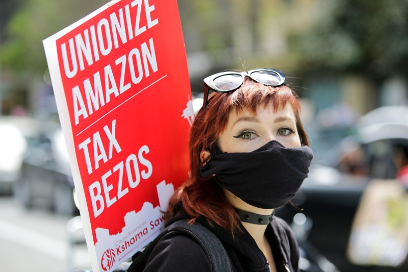 Protesters in Seattle demand Amazon be taxed.