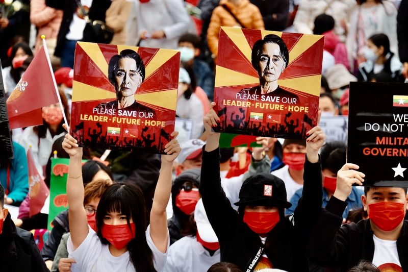 People from Myanmar living in Taiwan display portraits of deposed Myanmar State Counselor Aung San Suu Kyi at a protest in Taipei on March 21.