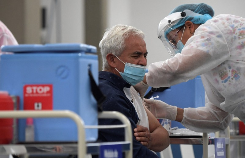 A man is inoculated with the Oxford-AstraZeneca vaccine against COVID-19 amid the coronavirus pandemic in Bogotá on April 7.