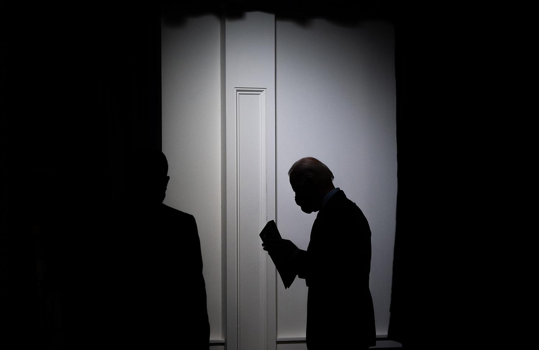 Joe Biden leaves the Eisenhower Executive Office Buidling.