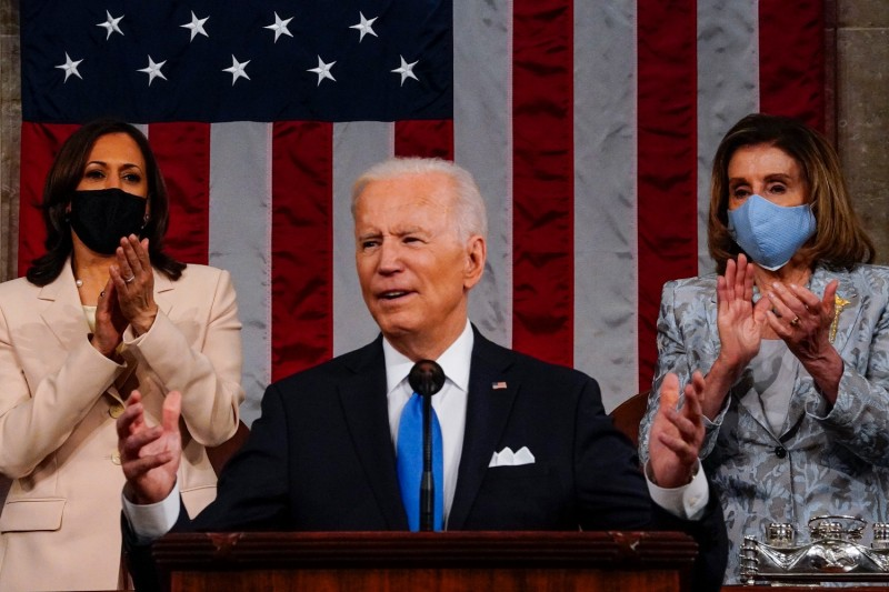Biden addresses Congress at the Capitol.