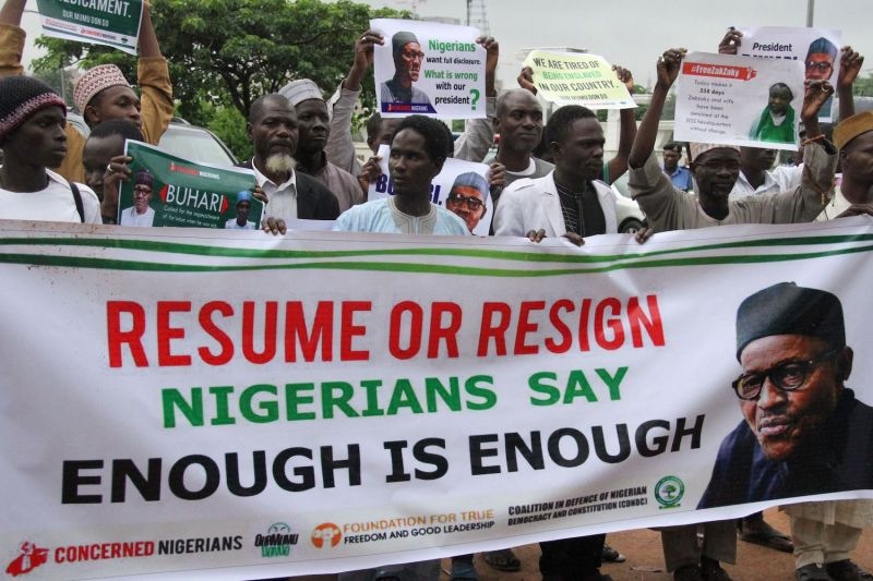 Protesters carry placards to demand that ailing President Muhammadu Buhari resume work or resign in Abuja, Nigeria on August 7, 2017.