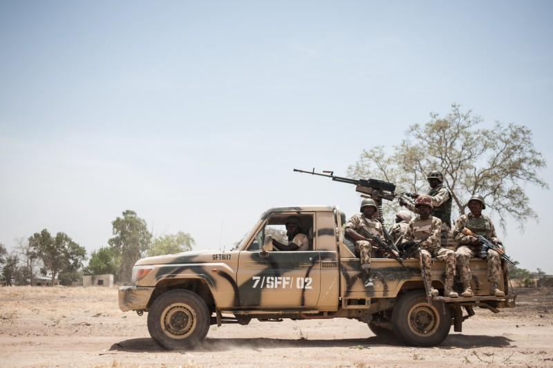 Soldiers of the 7th Division of the Nigerian Army sit on the back of a Military Toyota Land Cruiser at the Government Girls Secondary School in Chibok, northeastern Nigeria, on March 25, 2016.
