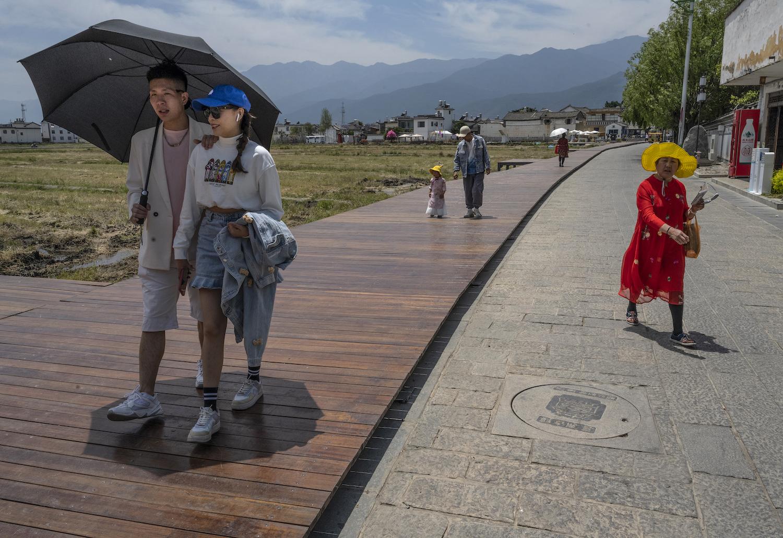 Tourists walk on a platform in Dali City, China, on April 25.