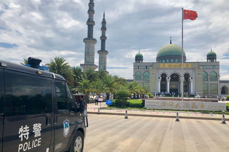 A police van outside the Grand Mosque in Shadian, China.