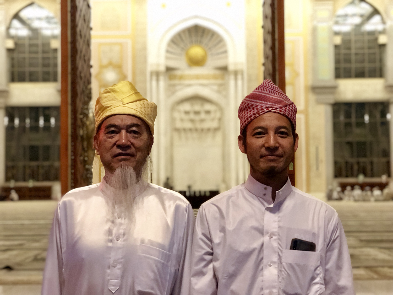Two imams outside the Grand Mosque in Shadian, China.