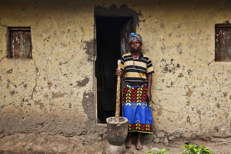 Jane Tomushana, whose husband was killed by an elephant while collecting firewood from inside the park, stands outside her home in Kyambura on Feb. 6, 2020.