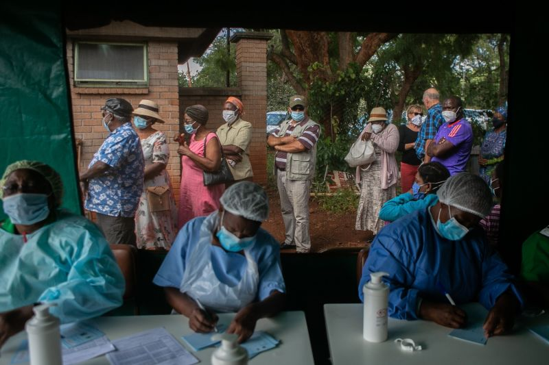Older people queue for the Sinopharm COVID-19 vaccine outside a tent as nurses work at a local hospital in Harare, Zimbabwe, on March 29.
