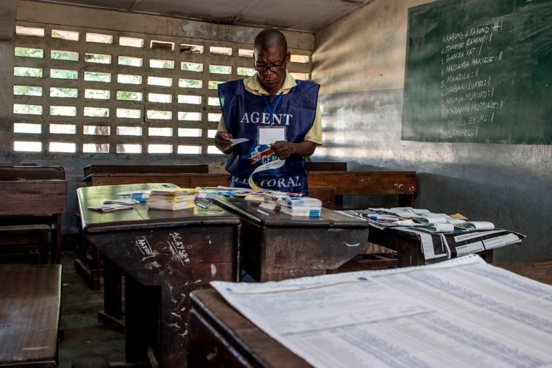 An electoral agent arranges ballots.