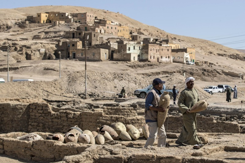 "Workers carry pots at the archaeological site of a 3,000-year-old city dating to the reign of Amenhotep III—dubbed the ""Rise of Aten""—which was uncovered by an Egyptian mission near Luxor, Egypt, on April 10."