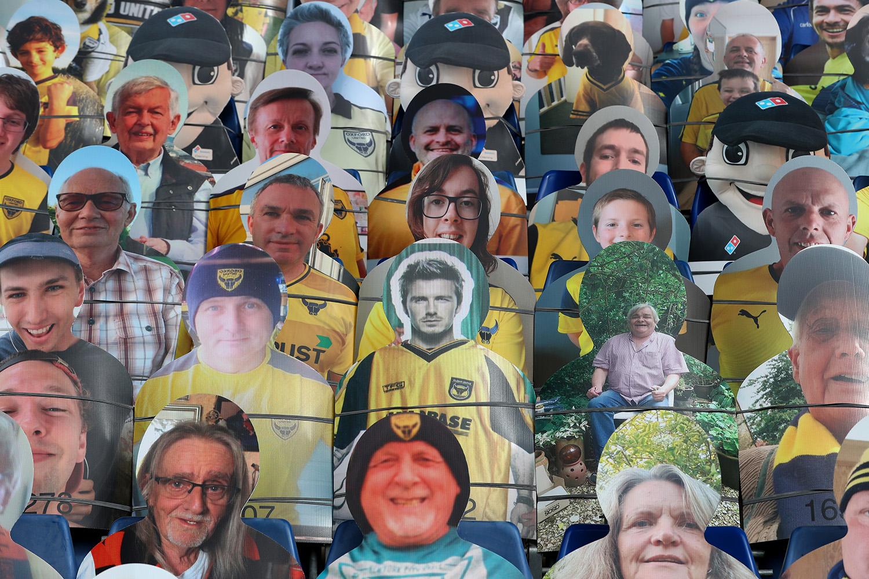 Cardboard cutout fans, including David Beckham, at a English soccer match during coronavirus restrictions.