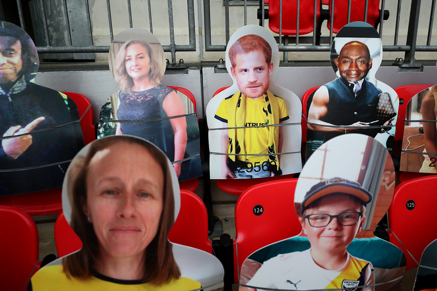 Cardboard cutout fans, including one of Prince Harry, at a English soccer match during coronavirus restrictions.