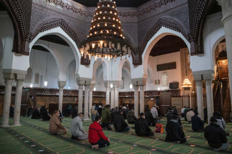 People pray in the Great Mosque of Paris.